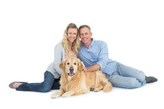 Portrait of smiling couple sitting together with their dog Royalty Free Stock Images