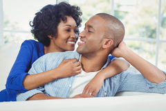 Portrait of smiling couple on the sofa Stock Photo