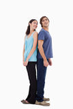 Portrait of a smiling couple standing back to back Royalty Free Stock Image