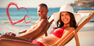 Portrait of smiling couple on their deck chairs Stock Photo
