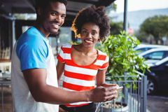 Portrait of smiling couple using mobile phone Royalty Free Stock Image