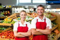 Portrait of smiling couple wearing apron Stock Photography