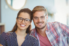 Portrait of smiling couple wearing spectacles. In office Royalty Free Stock Photos