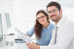 Portrait of smiling coworkers brainstorming Stock Images