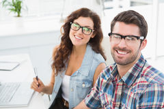 Portrait of smiling coworkers with glasses Royalty Free Stock Images