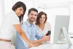 Portrait of smiling coworkers posing together Stock Image