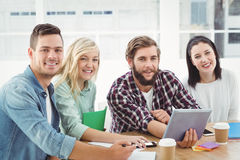 Portrait of smiling creative business people using digital tablet Stock Image