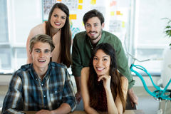 Portrait of smiling creative business team posing together Stock Photo