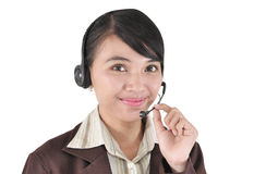 Portrait of a smiling customer service girl. Isolated on white background Royalty Free Stock Image