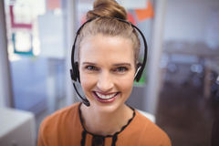 Portrait of smiling customer service representative in office Royalty Free Stock Images