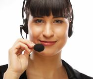 Portrait of smiling customer support female phone worker, over w Royalty Free Stock Photography