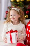 Portrait of  smiling cute girl with Christmas gift Stock Images