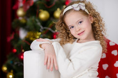 Portrait of  smiling cute girl with Christmas gift Stock Photos