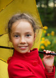 Portrait of smiling cute girl in red jacket with umbrella outdoor Royalty Free Stock Images