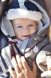 Portrait of smiling cute little baby boy wearing warm winter hat Stock Photo