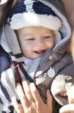 Portrait of smiling cute little baby boy wearing warm winter hat Stock Photography
