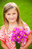 Portrait of a smiling cute little girl with flowers Royalty Free Stock Images