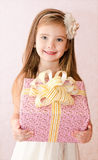 Portrait of smiling cute little girl with gift box Stock Photo