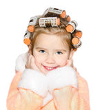 Portrait of smiling cute little girl in hair curlers Royalty Free Stock Image