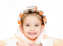 Portrait of smiling cute little girl in hair curlers Royalty Free Stock Photo