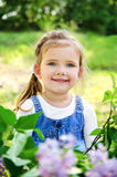 Portrait of smiling cute little girl outdoors Stock Photos
