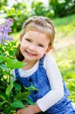 Portrait of smiling cute little girl outdoors Stock Image