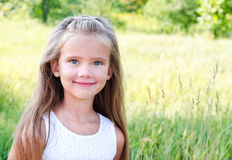 Portrait of smiling cute little girl in summer day Royalty Free Stock Photos