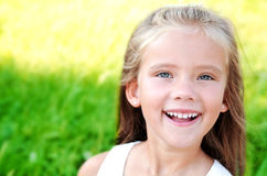 Portrait of smiling cute little girl in summer day Stock Images