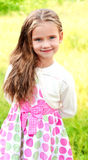 Portrait of smiling cute little girl in summer day Stock Image