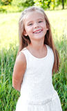 Portrait of smiling cute little girl Royalty Free Stock Photos