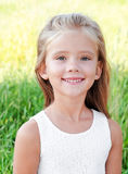 Portrait of smiling cute little girl Stock Image