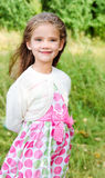 Portrait of smiling cute little girl in summer day Stock Photo