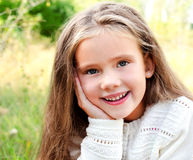 Portrait of smiling cute little girl in summer day Stock Photos