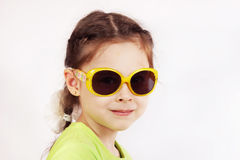 Portrait of a smiling cute little girl with sunglasses Royalty Free Stock Image