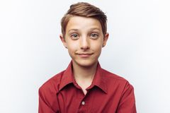 Portrait of smiling cute teen on white background, in red shirt, advertisement, text insert. Portrait of smiling cute teen on white background, in red shirt stock photos