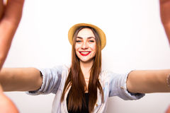 Portrait of a smiling cute woman making selfie photo from hands Royalty Free Stock Image