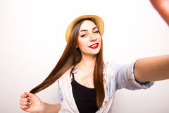 Portrait of a smiling cute woman making selfie photo from hands Royalty Free Stock Photos