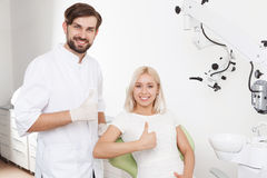 Portrait of smiling dentist and patient Stock Images