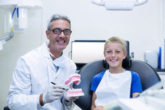 Portrait of smiling dentist and young patient Royalty Free Stock Photography