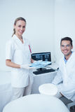 Portrait of smiling dentists with computer monitor Royalty Free Stock Images