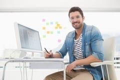 Portrait of smiling designer with digitizer Stock Images
