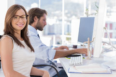 Portrait of smiling designer with reading glasses Stock Photography