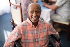 Portrait of smiling disabled senior man sitting on wheelchair Royalty Free Stock Images