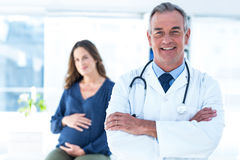 Portrait of smiling doctor with pregnant woman at clinic Stock Photography