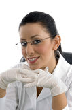 Portrait of smiling doctor wearing hand gloves Stock Photo