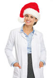 Portrait of smiling doctor woman in santa hat Royalty Free Stock Images