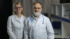 Portrait of smiling doctos in hospital office stock footage