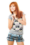 Portrait of smiling dreamy red-haired girl Stock Image