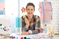 Portrait of smiling dressmaker woman in studio Stock Image