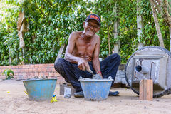 Portrait of smiling elder worker, Cambodia Royalty Free Stock Images